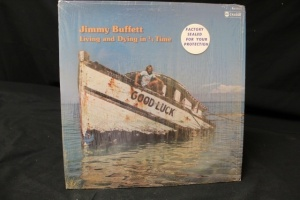 7 Vintage LP's Featuring Artist: Jimmy Buffett, Creedence Clearwater Revival, Colossus Gold