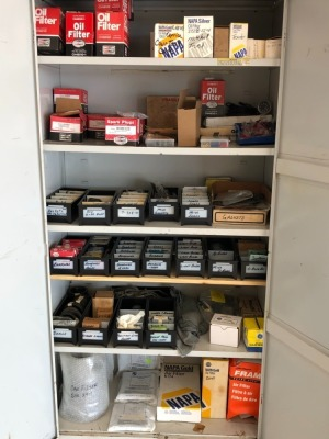 Metal Cabinet with Miscellaneous Parts: Oil Fliters, Spark Plugs, Gaskets, Bearings, Seals, Brake Pads, Air Filters & Can Filters