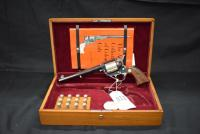 150 year Anniversary Colt Sesquicentennial Colonel Samuel L. Colt 1814-1964 Colt .45 SAA Revolver Set. Comes with wooden presentation box, Sam Colt Medallion, .45 Shell Casings in wooden box and History of Colt Book. Gun is in box, in mint condition and i
